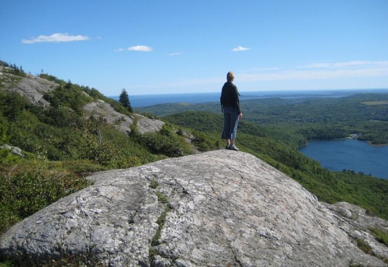hiker looking over camden and rockport penobscot bay