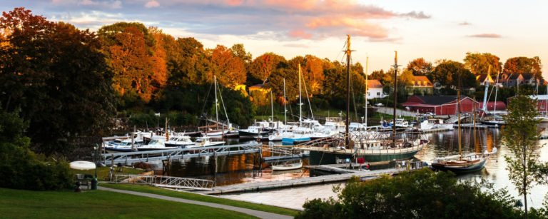 harbor at camden maine with boats during fall season - things to do in camden maine