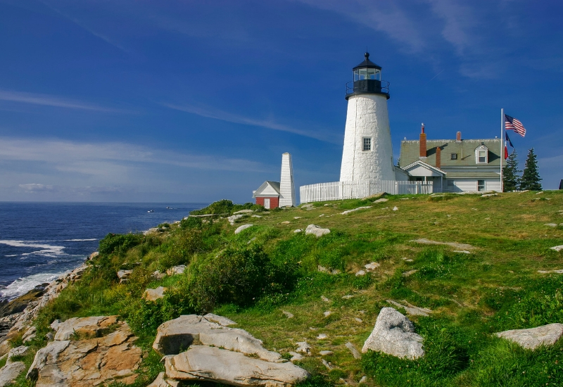 Museums and Lighthouses to Explore in Rockland Maine - white lighthouse on a hill overlooking ocean