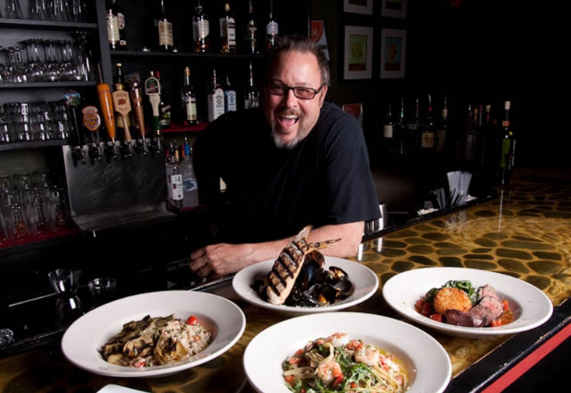 Restaurants in Rockland Maine - Rustica Restaurant Chef with his dishes
