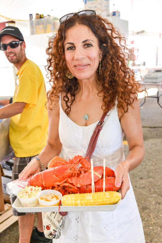 9 things you didn't know about the maine lobster festival - woman eating lobster