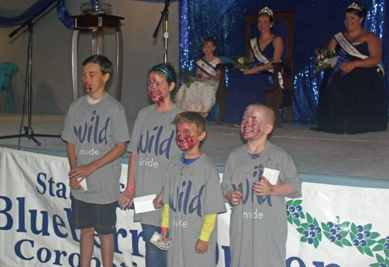 winners of the blueberry pie eating contest at the Wild Blueberry Festival & Union Fair Maine